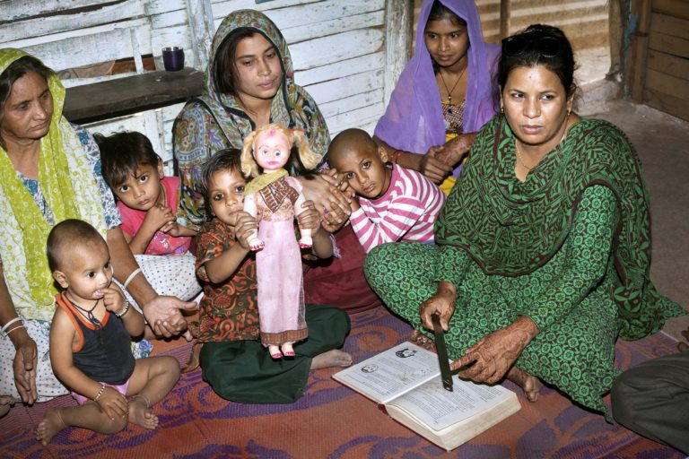 Community health workers educate the people in the slums.