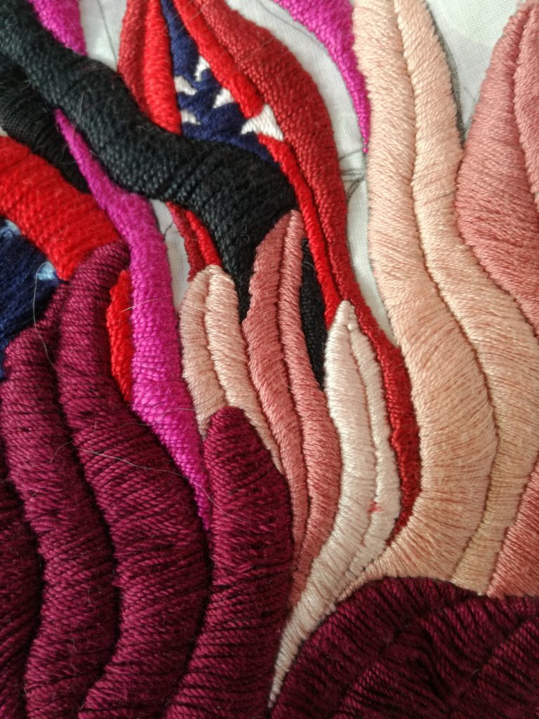 Hand embroidery on a bed sheet - detail