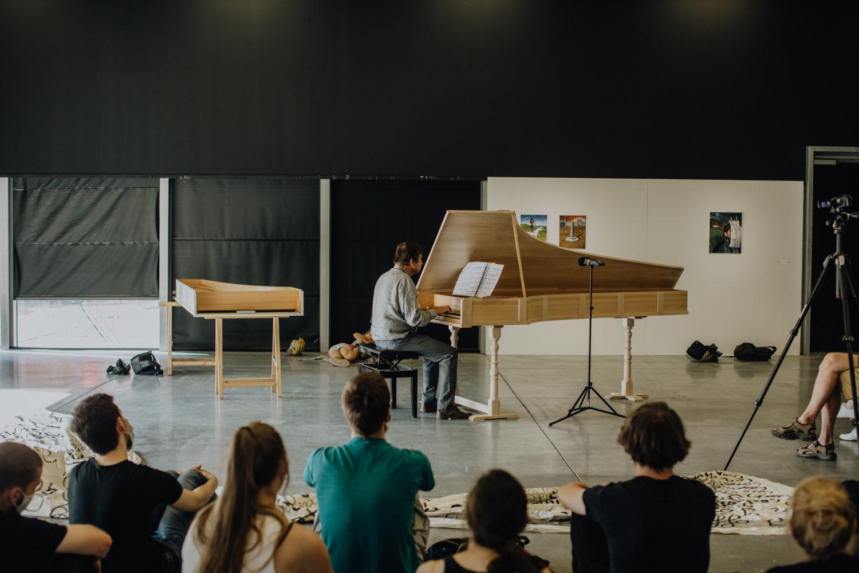 Guy Penson playing the piano. Photo by Cheyenne De Keyser.